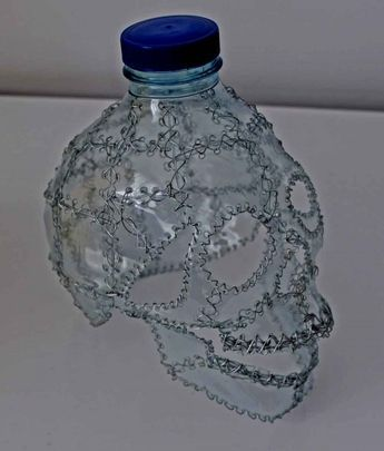 Copia de IMG 0222 600x706 Skulls recycling in plastics art with Upcycled Recycled Plastic Bottle Art