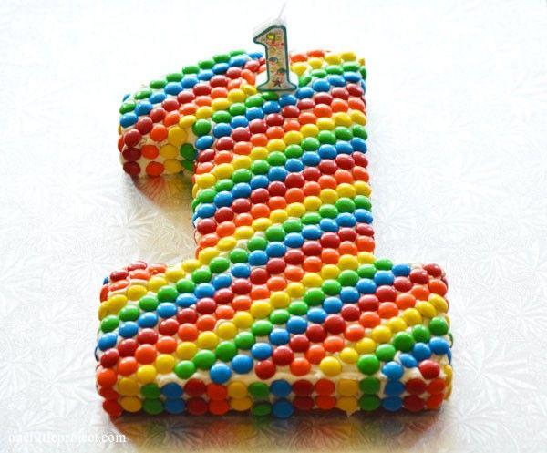 Rainbow party ideas: rainbow M's first birthday cake