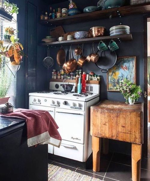 dark paint and mixture of textures and colours in the kitchen