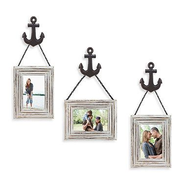 anchors mounted to hang distressed frames in the lighthouse themed bathroom as decos