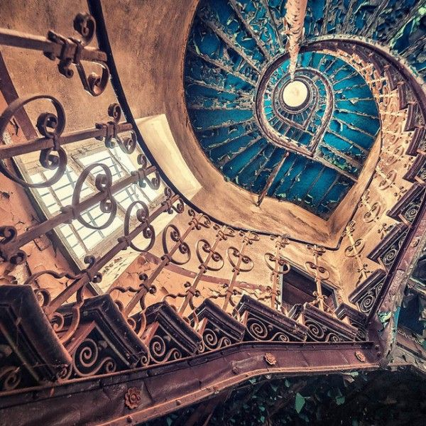 Blue spiral staircase - abandoned European castle