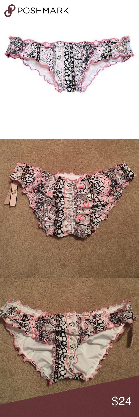 Victoria's Secret Ruffle Cheeky Bikini Bottom Cheeky bathing suit bottom with ruffles along the edges. Lower cut, looks very good on. Light pink and black paisley print with a little by of gold shimmery details. New, never worn! Will come in original packaging! This item is no longer sold in stores or online. Victoria's Secret Swim Bikinis
