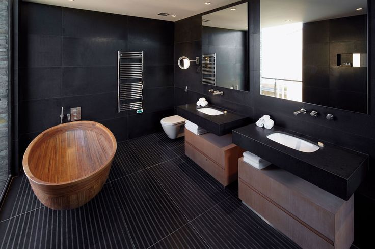 Luxury Black Bathroom with wooden tub | A wooden bathtub can also be a great add to match any black bathroom design set | #blackbathrooms #bathroomdesign #luxurybathrooms