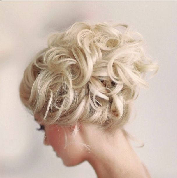 Enchanting loveliness - woven waves and curls in a seductively demure up-do that will look simply divine if left completely  unadorned or sprinkled with glittering jewels and veiled.