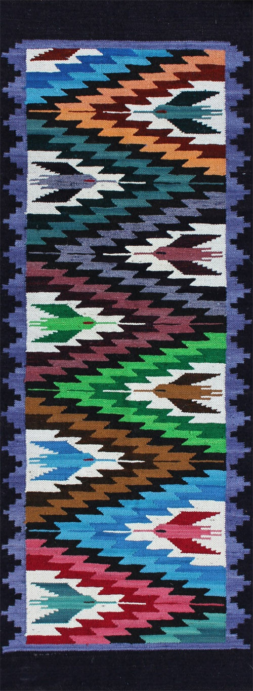 "rug #: 2-104  type:   Peruvian Weaving  origin: Peru  size: 1'10"" x 5'0""    This playfully executed hummingbird design uses bright colors to intensify it's delight for life, contrasting the birds with a geometric energy of lightening with zig-zags.  The colors in this electrifying runner could be a great addition to any child's room.    This one of a kind work of art is all handmade with natural materials and vegetable dyes, and was purchased directly from the artisan who produced it."