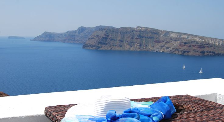 The view from windmill at Golden Sunset Villas, in #Oia_Traditional_Village.