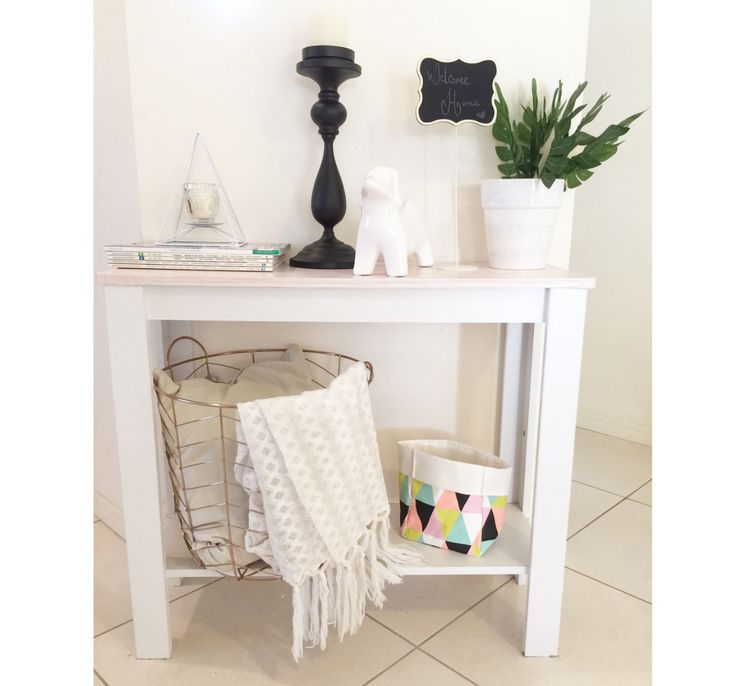 Kmart hack on the side table with wood grain contact on top . Instagram : mylittleplaceofhome