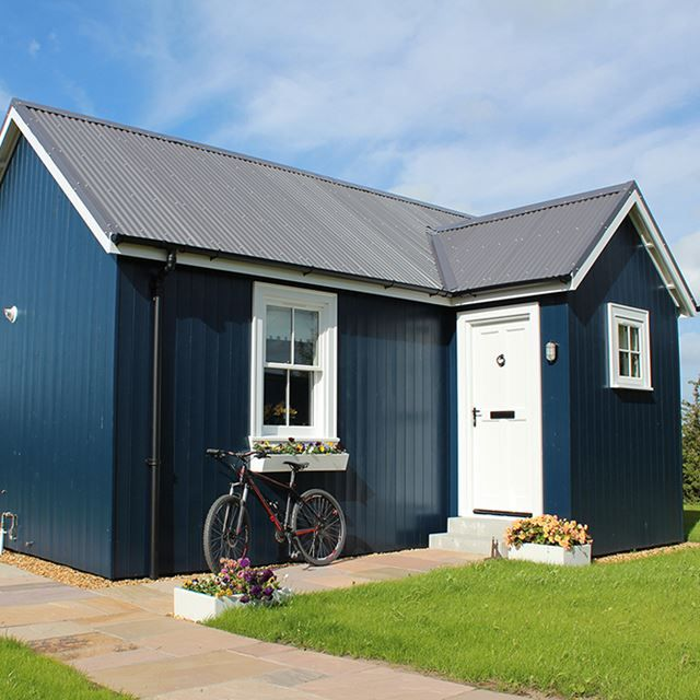 One Bedroom House | White Door | Flowers | Timber Exterior | Wee House |  Cycling