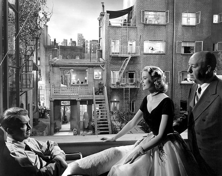 Jimmy Stewart, Grace Kelly and Alfred Hitchcock on the set of The Rear Window