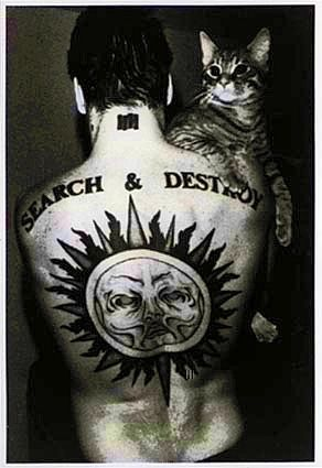 Noted tough guy Henry Rollins shows his softer side. | Community Post: 38 Musicians Cradling Cats