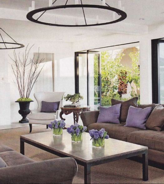 a gorgeous transitional living room with sofa and purple accents