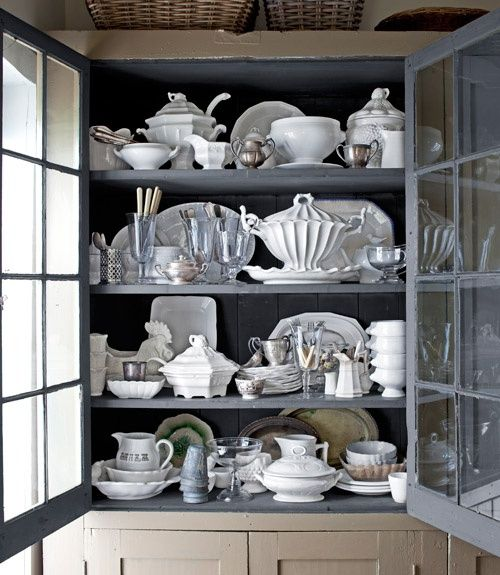 Makes me want to repaint my white china cabinet and run out to buy multiple tureens and pitchers that will serve little utilitarian purpose.  Via Pink Wallpaper.