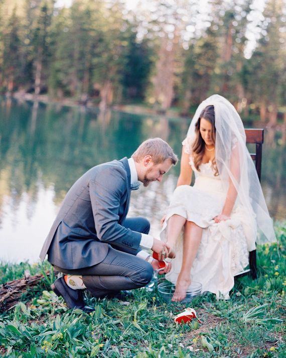 """For a sort of purifying ritual, you and your groom could either perform a """"washing of the feet"""" or have your officiant pour a pitcher of water over your hands. The act symbolizes the release of any past emotional blocks, so both parties can enter the marriage with open hearts. This cleansing ceremony works especially well in outdoor weddings where messiness is not a concern. Indoors, couples can hold their hands over a bowl or share a goblet of water to symbolize the purity of love."""