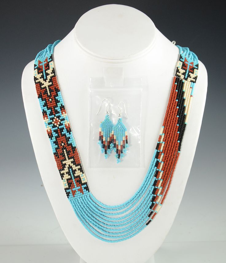 """-- INQUIRE -- ITEM NUMBER: NEC9507 ARTIST: Rena Charles TRIBE: Navajo DIMENSIONS: Measures 29"""" Long By 1"""" Wide MORE DETAILS: Eye-Catching Handmade Beaded N"""