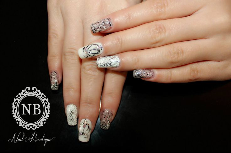 silver and white manicure with a beautiful crown painted on nails