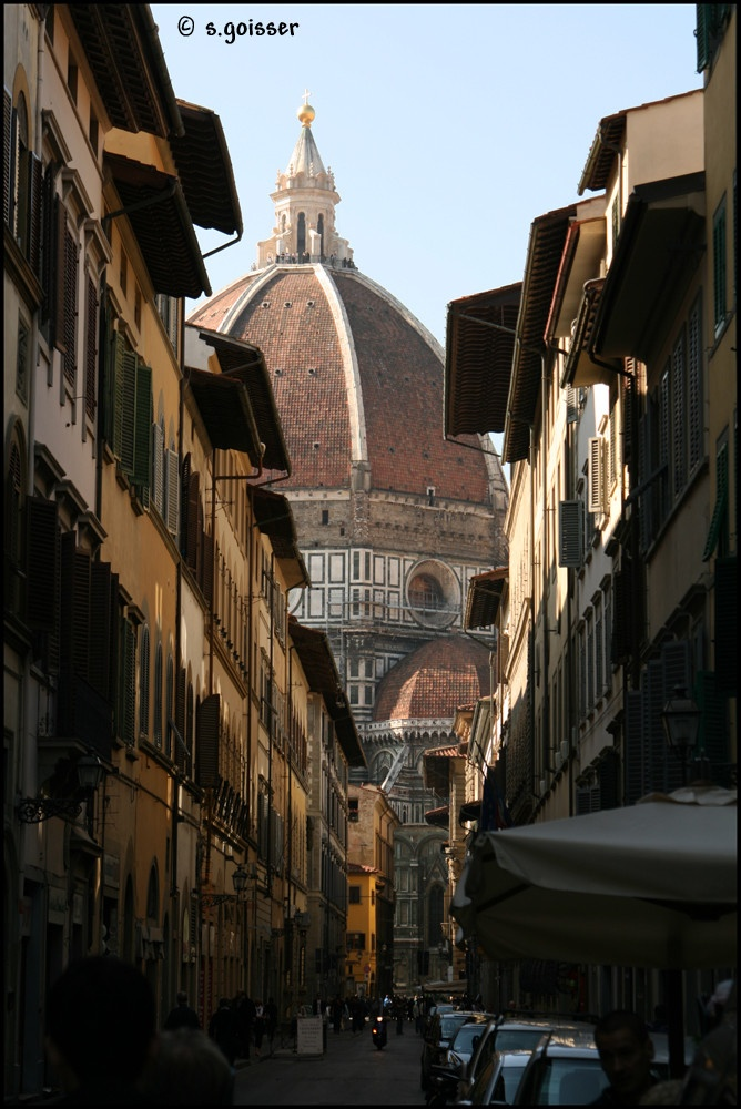 Typical side street in Florence, view of the Duomo.