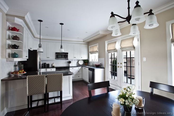 kitchens with seating at a peninsula | kitchen-cabinets-traditional-white-155-s42751594x2-peninsula-seat ...