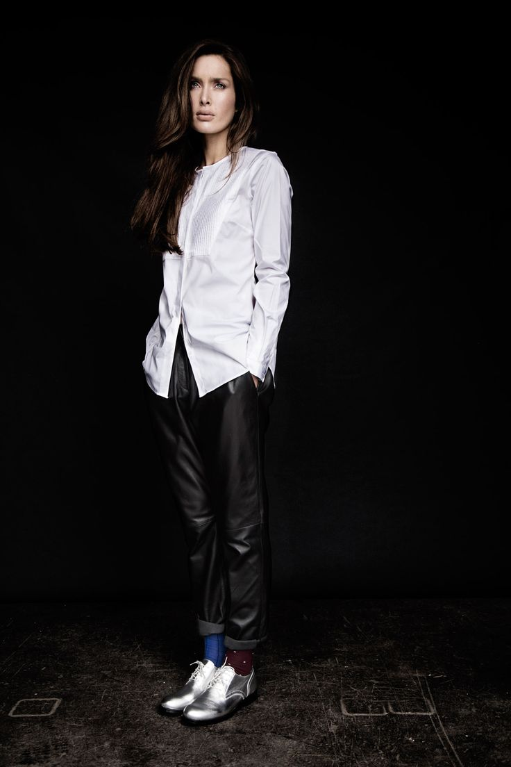 Panelled white shirt paired with loose-fitting leather trousers and silver brogues, all Carolyn Donnelly The Edit