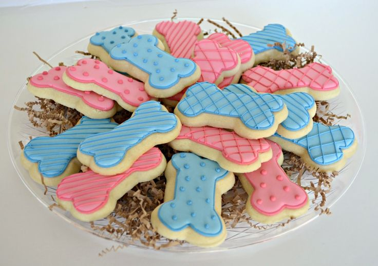 Dog bone decorated sugar cookies for humans. Royal icing. Pink, blue. Polka dots, stripes.