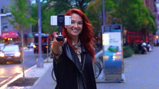 The SMOVE stabilizes and charges your phone for steady video shoots