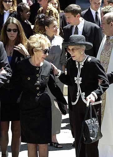 Nancy Reagan and Jane Wyman, 1st wife of President Reagan and mother of Maureen Reagan, leaving the church after the funeral services for Maureen in 2001.
