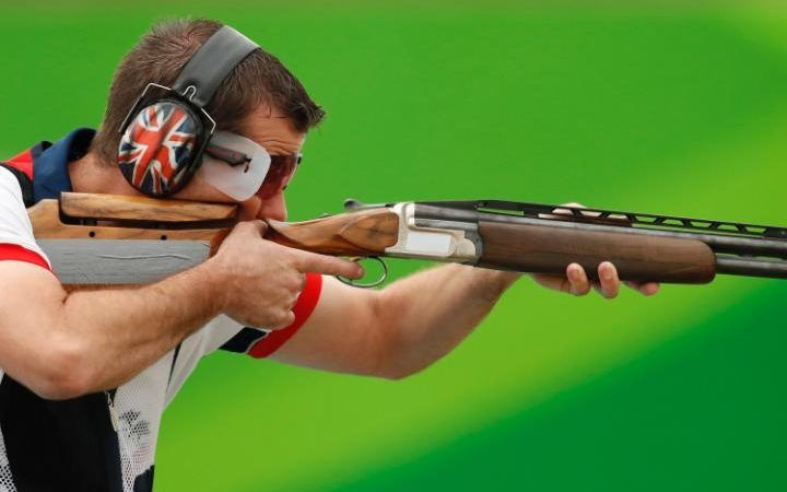 Great Britain's Edward Ling ejects a spent cartridge after shooting during men's trap qualification at the 2016 Summer Olympics