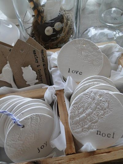 clay tag stamped with doily and letters-Maybe part of our centerpieces or our…
