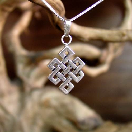 Tibetan Knot (Srivatsa or endless knot):  Is one of the wight  symbols of the Tibetan Buddhism.  The Tibetan knot stands for karmic consequences: pull here, something happens over there.  It is an apt symbol for the Vajrayana methods. Often when we tug at one part of a knot while trying to loosen it, another part gets tighter.