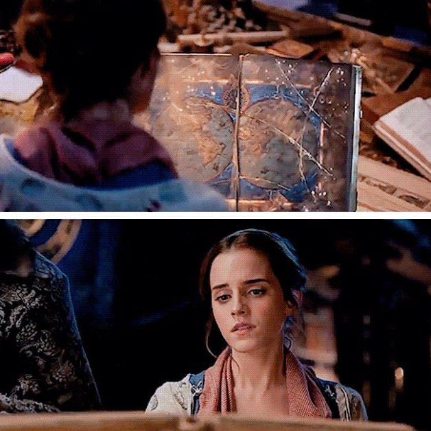 Belle looking at the ancient book