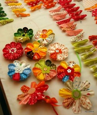 diy fabric flowers: she has a wonderful step by step tutorial on how to make them.