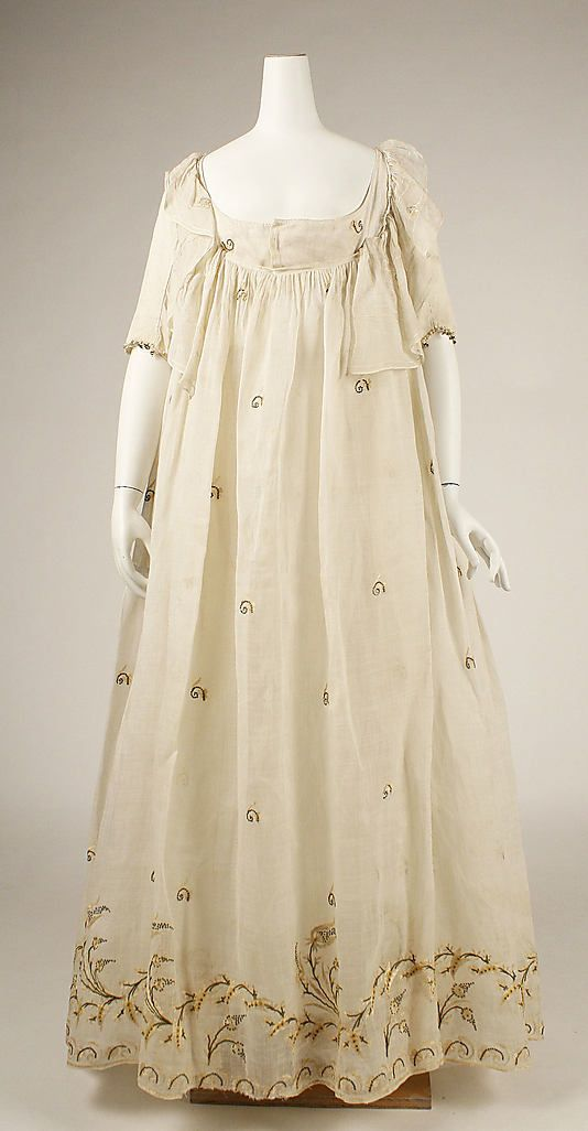 Gown, late 1790s. American or European. Cotton. Met, 1995.5.5.  [Extra fabric at front bodice probably wrapped or drawn up and pinned to the neckline, like a ruffle or collar. Center Front opening for the dress.]
