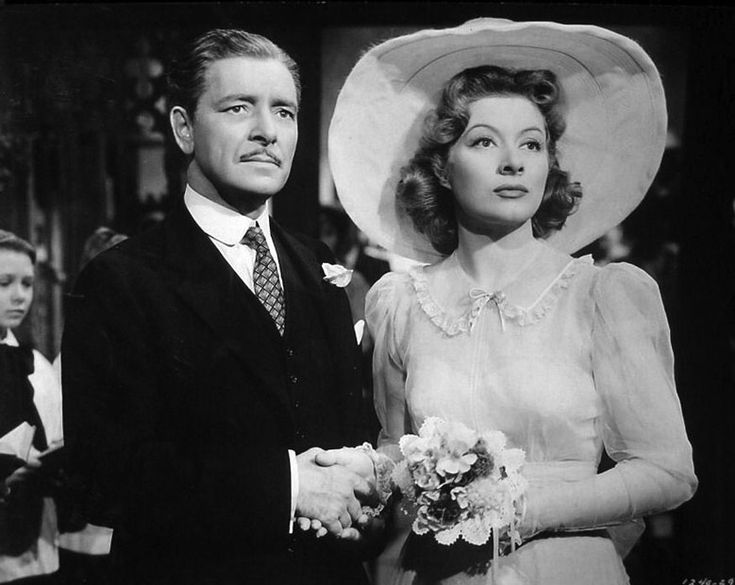 """Ronald Colman and Greer Garson - Random Harvest. - 1942 --In this great romantic film, wealthy aristocrat Charles Rainier (Ronald Colman) sustained a shell-shocked head injury during WWI and became an amnesiac named John Smith-""""Smithy""""; he falls in love with actress Paula Ridgeway (Greer Garson) who takes him to a cottage to recuperate where he asks her to marry him"""