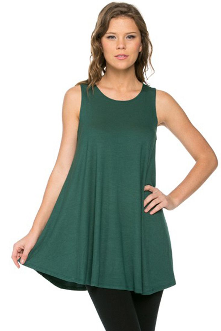 - Fabric: 95%Polyester 5%Spandex - Made in USA - Comfortable and loose fitting sleeveless tunic top - Hand or Gentle Machine Wash - Available in Black, Ivory, Navy, Charcoal, Dark Brown, Royal Blue, E