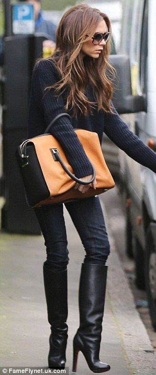 How to: Fashionista: But Victoria still looked as chic as ever in her outfit, which consisted of a blue chunky jumper, jeans and black knee-high boots
