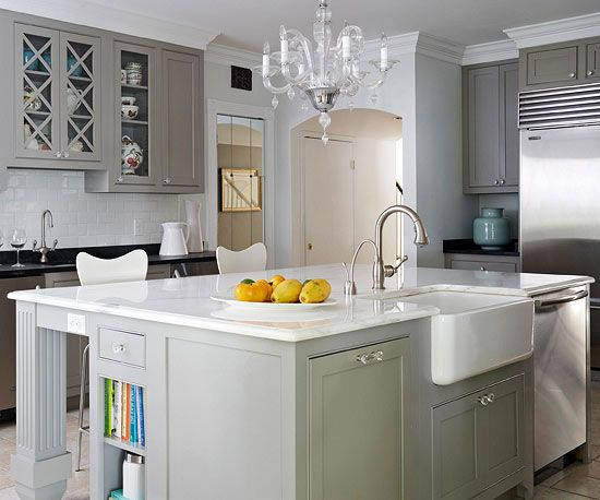 Pretty grey cabinets with added sparkle in the fixture.