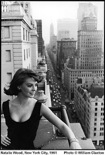 Natalie Wood above Fifth Avenue, probably from the Sherry Netherland hotel (the Savoy Plaza Hotel behind her was torn down for the GM Building in the early '60s)