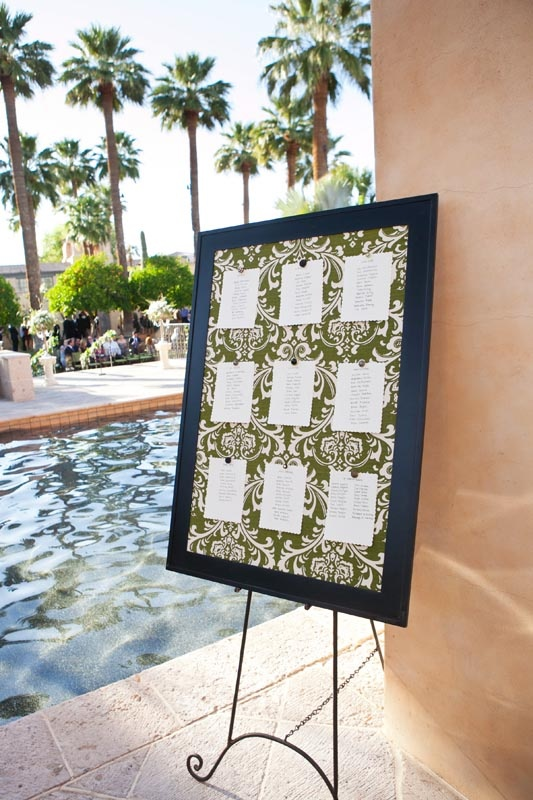 seating chart display in more formal frame. pinned to white fabric.