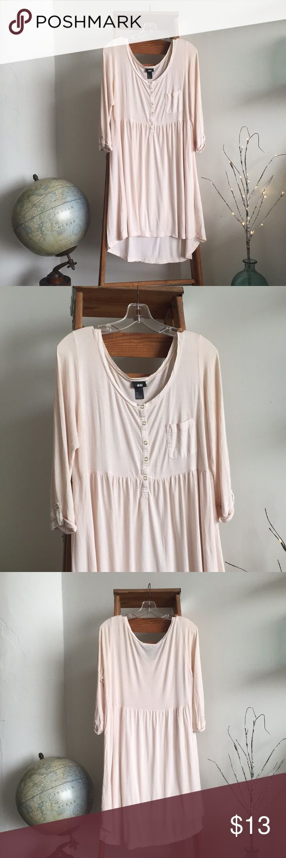 💥SALE t.w. ONLY💥H&M Babydoll 3/4 Sleeve Dress Sweet and flowy, in the lightest softest shade of pink. Cute with leggings and a sweater or even just as a nightgown 💗  Super lightweight knit 100% viscose; gold snap button detailing down the front and a snap button sleeve roll; small chest pocket; drop hem is a little longer in the back  Lightly loved- hence the awesome price! Last photos show very light pilling under arms and on rear end, and a small hole near bottom right hemline on the…