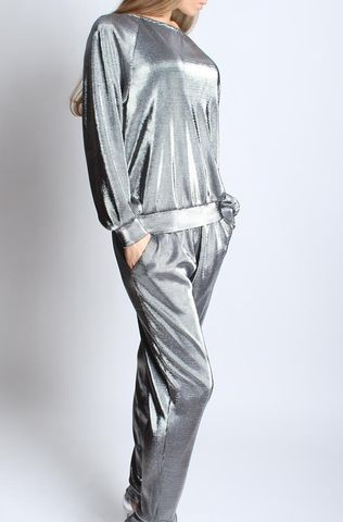 Luxurious silver urban chic suit. Consists of the long-sleeve top and trousers. Dress it up with heels and delicate jewellery.