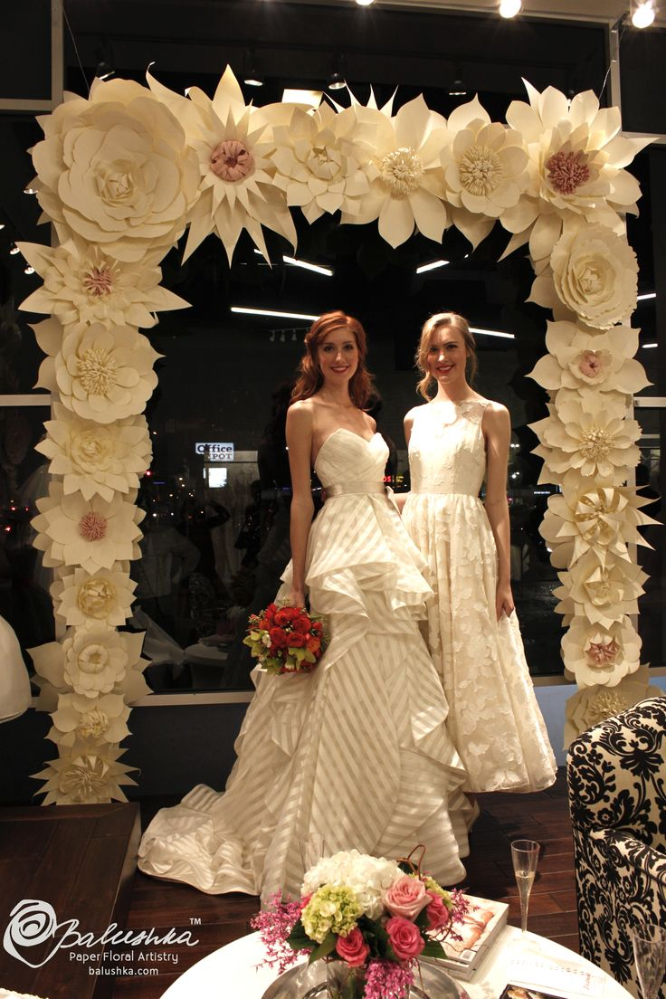 Handmade paper flower arch for a bridal fashion show.