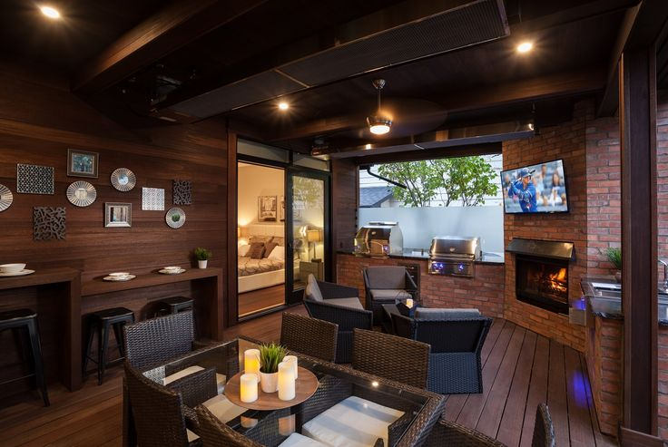 Great place to watch the game in this Red Balau Batu Outdoor Room supplied by Kayu Canada Inc. Step up your game!