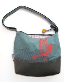 screenprinted blackbird on a cotton and leather bag.