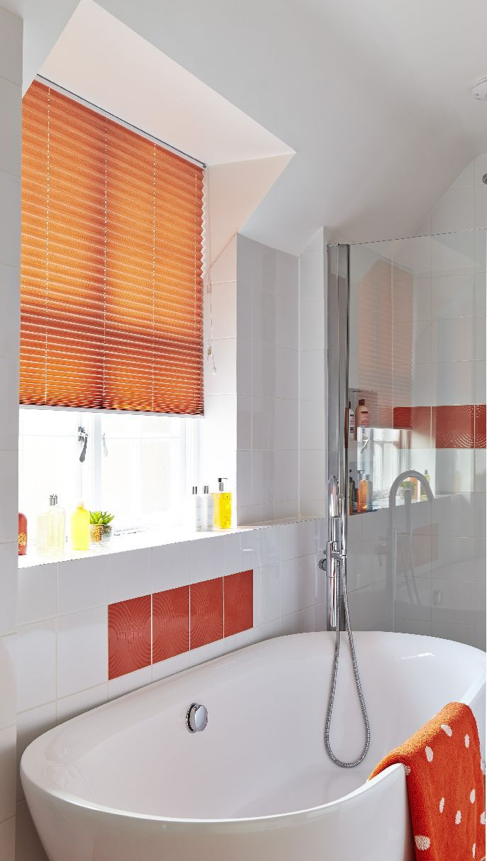 Add accents of colour into your bathroom with tiles and coordinating accessories. Made to measure orange pleated blinds would work wonderfully with this theme. Great for bathrooms and bedrooms.