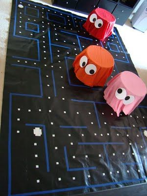 I graduated in the 80's, so I totally appreciate these party decorations! It's an 80s-themed birthday party! I would totally host a party like this and make these decorations! I love the pac-man game!