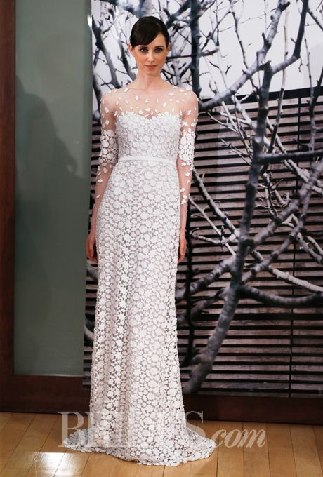 "Brides.com: Mira Zwillinger - 2014-2015. ""Fiya"" lace sheath wedding dress with an illusion high neckline and long sleeves, Mira Zwillinger"
