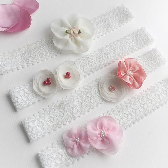 This is a beautiful set of toddler girl headbands (fits 1-3 years old), all made using an ivory stretch lace base, embellished with delicate fabric flowers. They are sold individually - each style is priced below - or as a set of four. They are perfect as flower girl headbands, as Christening hair accessories, party headbands for girls, and would make a lovely birthday gift, or goodie bag filler for a little girls birthday party. Little girls often love to feel pretty wearing their own…