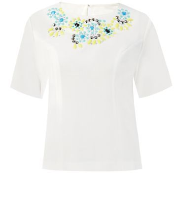 "Jumpo. Add this beaded top to bright blue skinny jeans and silver ankle strap heels, for a stand out style.- Beaded neck- Simple short sleeves- Round neck- Boxy design- Keyhole back- Soft breathable fabric- Model is 5'8""/176cm and wears UK 10/EU 38/US 6"