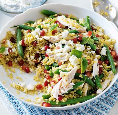 A colourful couscous salad with moist chicken, creamy feta, sweet pomegranate jewels and fresh mint yogurt.
