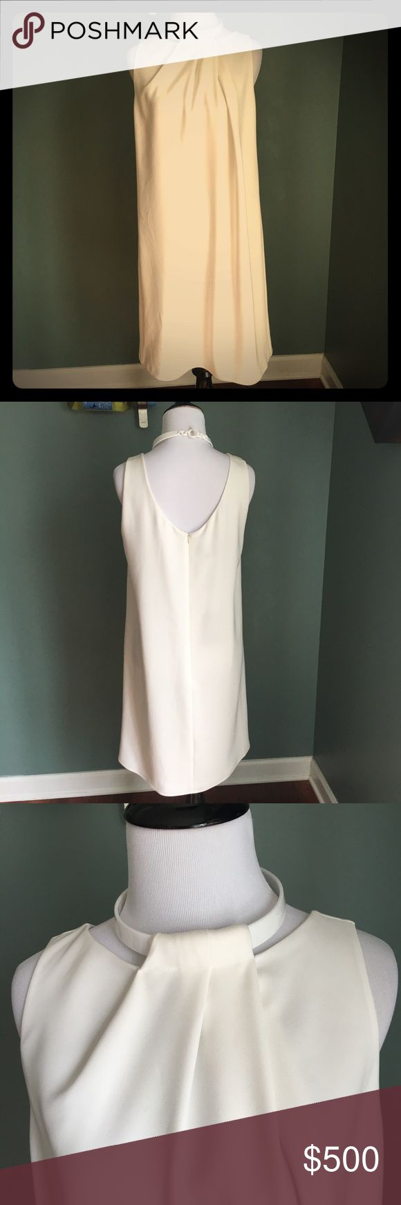 NWT Emporio Armani White Dress NWT Emporio Armani White Dress. Amazing dress. Perfect for spring and summer. Emporio Armani Dresses Midi