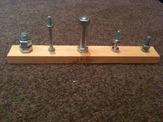 Nuts and bolts board for fine motor skills